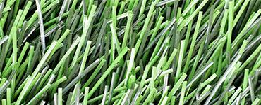 Изображение газона из искусственного материала зеленого цвета с высотой ворса 50 мм